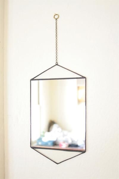 """This little wall hanging mirror is what we like to call a """"last look"""" mirror"""
