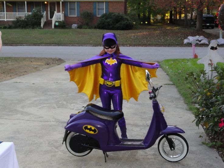 Little Batgirl and her Batcycle. Oh you know, just an early picture of me....