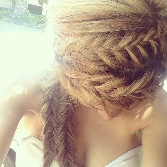 these would be a cuter version of pippi longstocking braids... I would do them different directions though, or braid it together at the end instead of having two braids on one side...