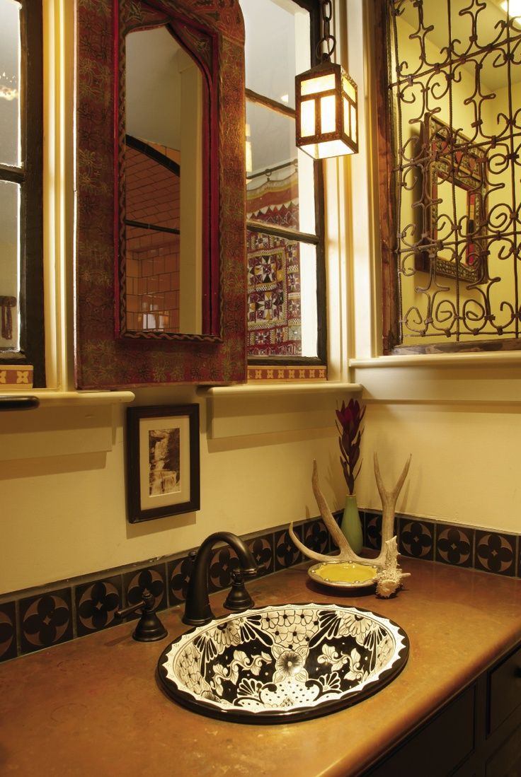 The bathroom blends Mexican and Mediterranean styles ...