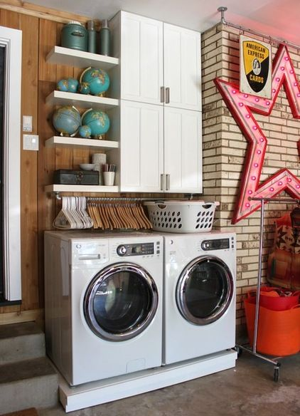 Love this bar hanging above the washer and dryer for hanger storage!