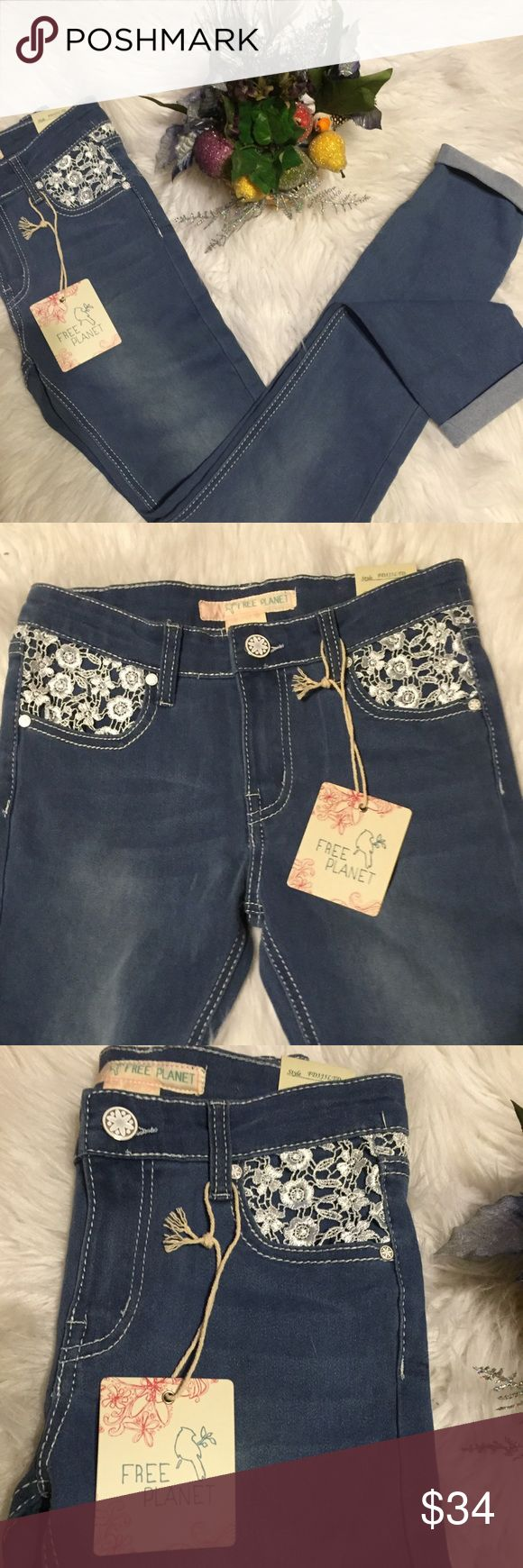 Free Planet lace embellished jeans Adorable jeggins with flower lace embellishments on front and back. These are new with tags from non smoking home Free Planet Bottoms Jeans