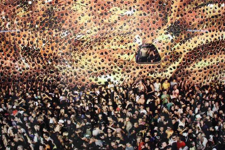 Cocoon II by Andreas Gursky is an image taken with strobe lights inside a darkened night club.