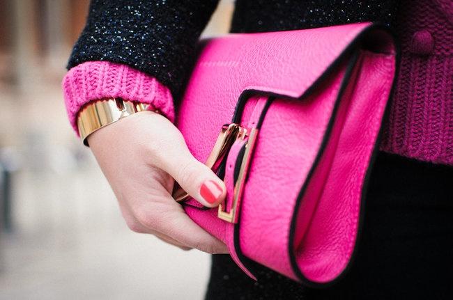 Coccinelle bright pink clutch