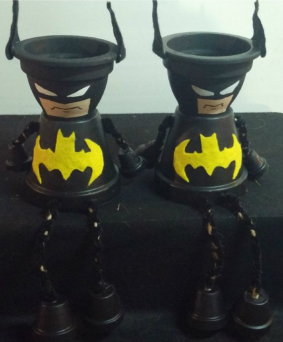 Hey, I found this really awesome Etsy listing at https://www.etsy.com/listing/215053666/batman-clay-pot-shelf-sitters