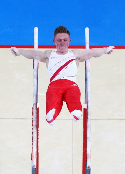 GLASGOW, SCOTLAND - JULY 29: Nile Wilson of England competes in the Parallel Bars during the Men'sTeam Final at SECC Precinct during day six of the Glasgow 2014 Commonwealth Games on July 29, 2014 in Glasgow, United Kingdom. (Photo by Ryan Pierse/Getty Images)