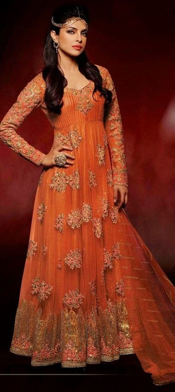 If I don't end up wearing a traditional phulkari outfit to the Sangeet, maybe something like this. That way the boys can still wear their orange Punjabi clothes...425504 Orange  color family Anarkali Suits,Bollywood Salwar Kameez in Net fabric with Lace,Machine Embroidery,Patch work .