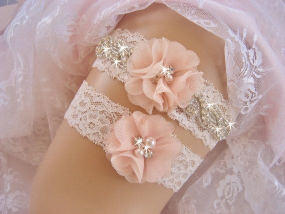 Ivory lace and crystal encrusted garter with clear Czech crystals. This beautiful garter is made with ivory 1 1/2 stretch lace. I added a trim
