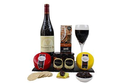 "A superb selection of <a href=""https://www.handmade-hamper.co.uk/product-category/cheeses/"">Cheese and wine Hampers</a>"