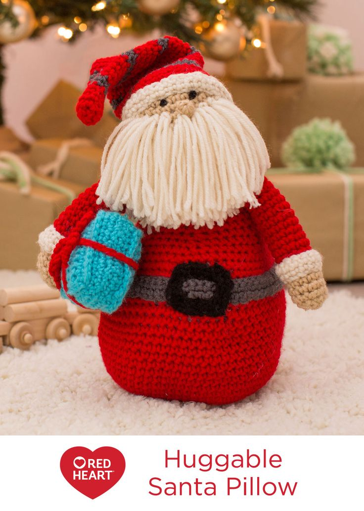 Huggable Santa Pillow Free Crochet Pattern in Red Heart Yarns -- This crocheted Santa is perfectly at home on the sofa, a shelf or the mantel, but kids may want to have him in their room watching while they sleep. Create this jolly fella for kids of all ages!