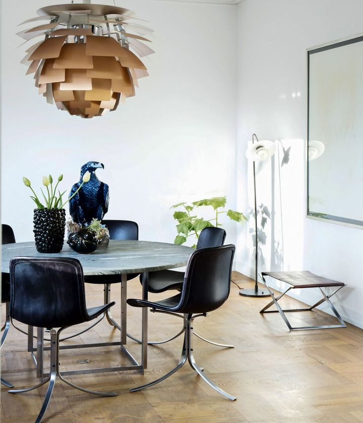 Contemporary Dining Room Using Modern Furniture And Golden Contemporary Chandelier In The Top Of Flower Vase And Eagle Ceramic Decor : The Right Dining Room Paint Colors To Setting The Mood