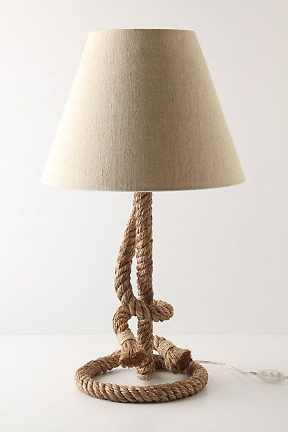 Anthropologie Riata Lamp Ensemble (Style No. 22902852), $168 via Anthropologie.Com --- This lassoed lighting fixture will be a coil of enlightenment in dark environments. Hard-backed jute shade is included and it measures 26.5in high with a 15in diameter. Lamp has a 60 watt lightbulb max with a 60in cord.