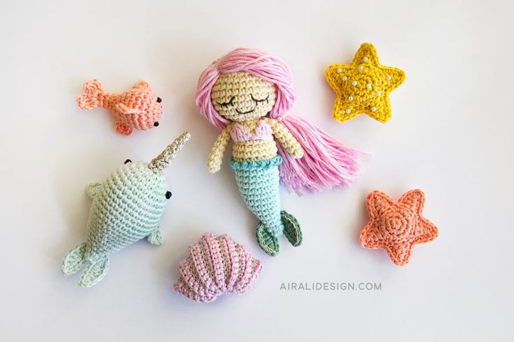 Amigurumi mermaid with her sea friends by Airali design on Mollie Makes. Crochet pattern and photo for: mermaid, narwhal, fish, starfish and elegant shell