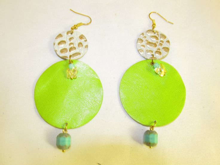 Handmade leather earrings (1 pair)  Made with light green leather, beige/gold embossed leather, swarovski butterflies and glass beads.