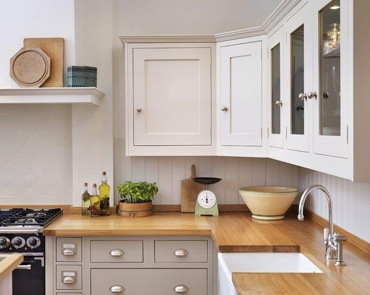 Shaker kitchen  Different colour units top and bottom - NB would like our cabinet cornice simpler than this one.