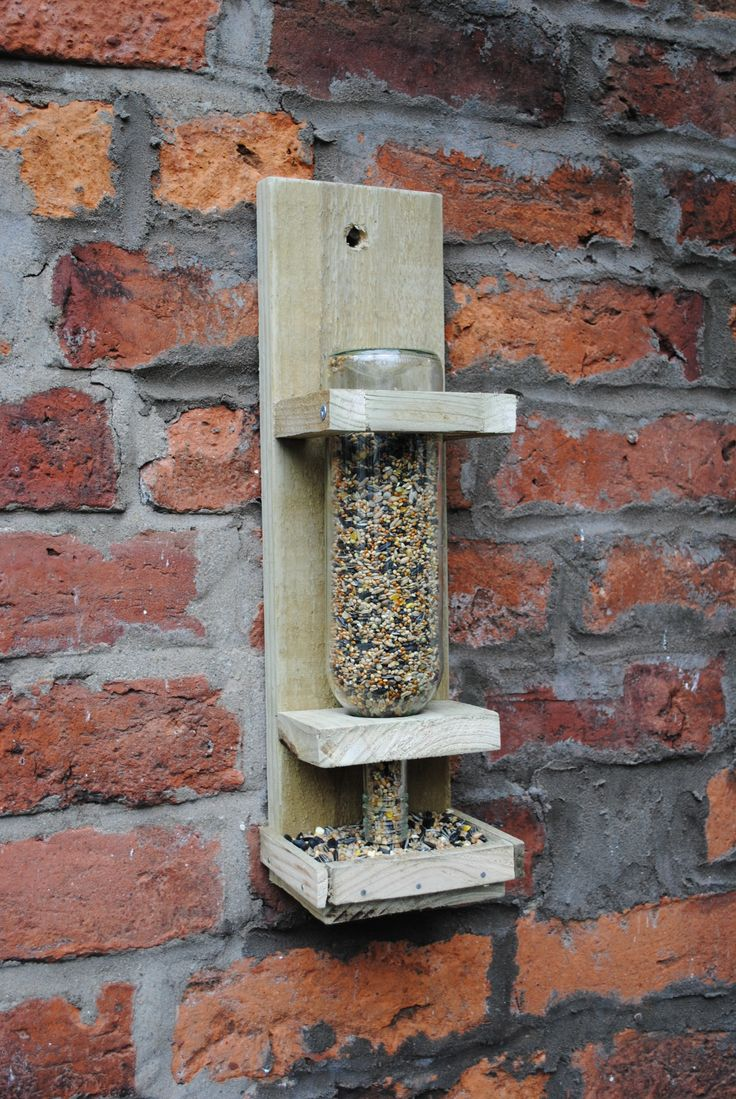 Wine bottle bird feeder. I would love a homemade one!!!!! #homesfornature