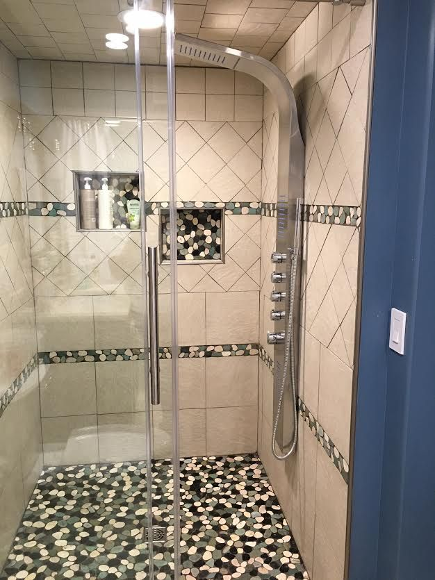 Stunning Shower Using Sliced Bali Turtle Pebble Tile On The Floor, Niches,  And Borders