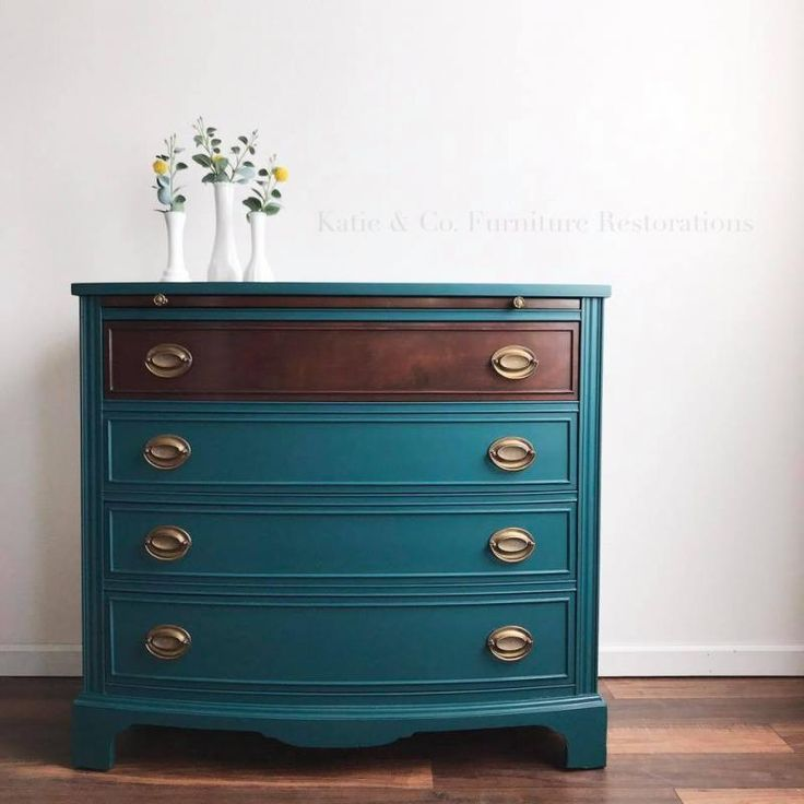 """When your wild color loving sister comes over and you drink a few glasses of wine....you make this crazy awesome color....and you have no idea the ratio of paints you used but it turns out to be the prettiest teal ever!"" - Katie & Co. Furniture Restorations This custom color was a mixture of GF Klein Blue, Lamp Black, Emerald and Snow White Milk Paint. Java Gel Stain was used to stain the top."