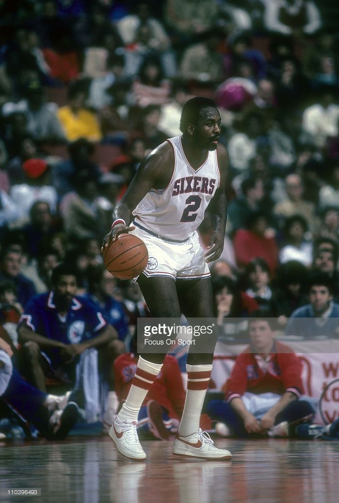 Moses Malone #2 of the Philadelphia 76ers in action against the New York Knicks during an NBA basketball game circa 1984 at the Spectrum in Philadelphia, Pennsylvania. Malone played for the 76ers from 1982-86 and 1993-94.