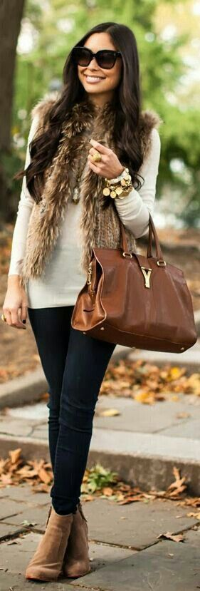 brown fur vest, white tunic, brown leggings, brown shooties and brown bag
