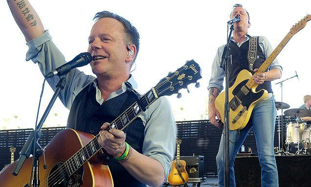 Kiefer Sutherland rocks out as he performs at California country music festival... after selling 3,400 copies of his debut album...