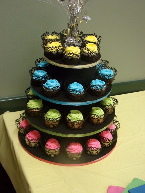 neon cupcakes on black tier stand