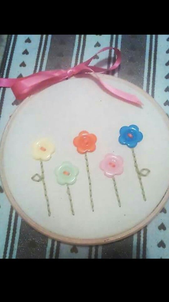Flower hoop i made for a friend. I used wilcos craft buttons, pound shop embroidery thread and the hoop and ribbon was from needlecraft corner in worksop.