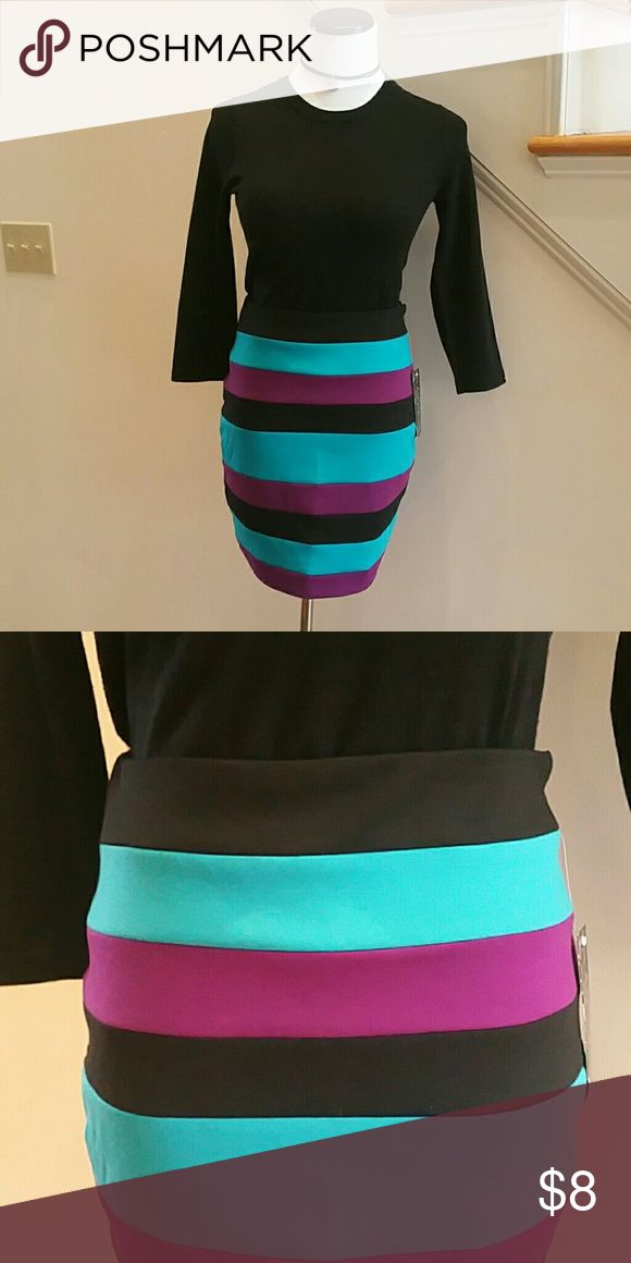 """Mini Skirt by Rampage Straight color-block bade skirt in teal, raspberry and black. Black boots, heels or flats, black tights, black sweater - """"It's a wrap!""""  High fashion and style made easy!  Fabric: 75% poly, 20% rayon, 5% spandex. L: 18 in. With tags. Never worn.  Women's size five (5). Good item to bundle for value and savings. Rampage Skirts Mini"""