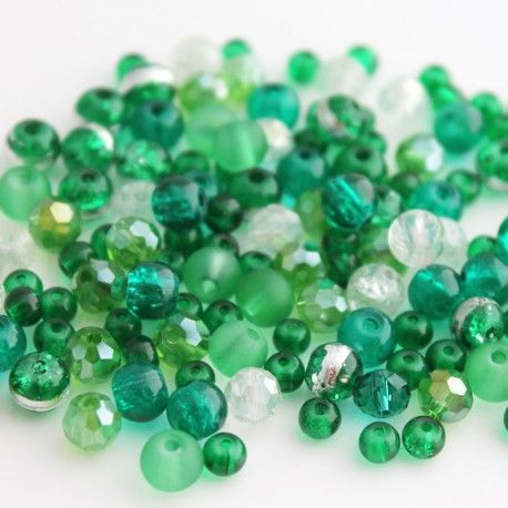 Pack of 30g assorted glass beads in mixed green colours, with some clear beads. Great for Christmas themed projects.