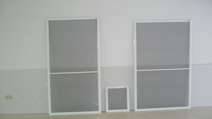 Showing 2 patio door mosquito screens both with mid rails and 1 small sliding screen. made by http://mosquitonick.ws