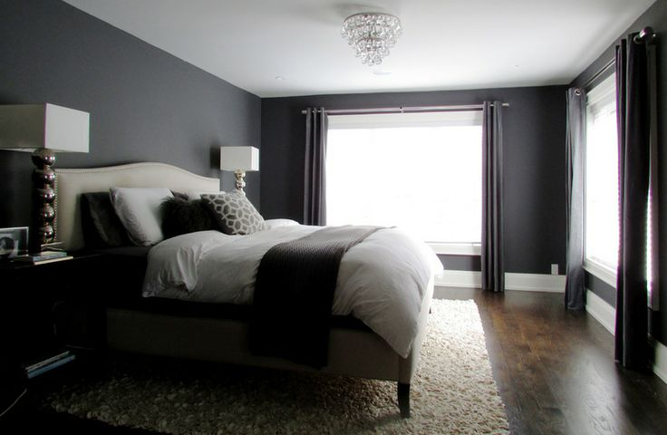 The couple's master bedroom is painted a deep charcoal with a hint of navy that beautifully sets off the chandelier. I really like this look because it's so dark and calming... exactly what you need in a bedroom.