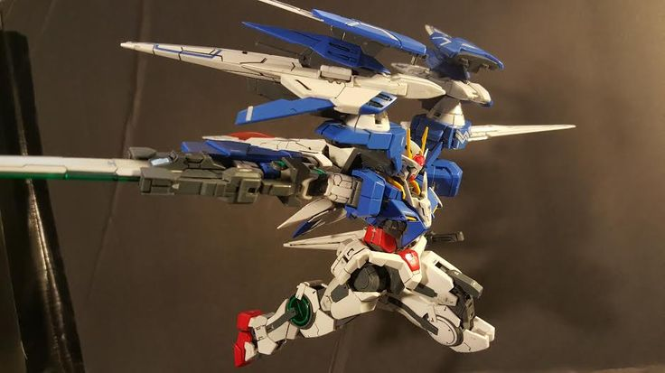 "Rasheed Gregory (USA) In this picture I have my favorite RG the OO Raiser that is only panel lined and decaled with its full weapon load out. I call this pose ""OO Raiser eliminating target!"""