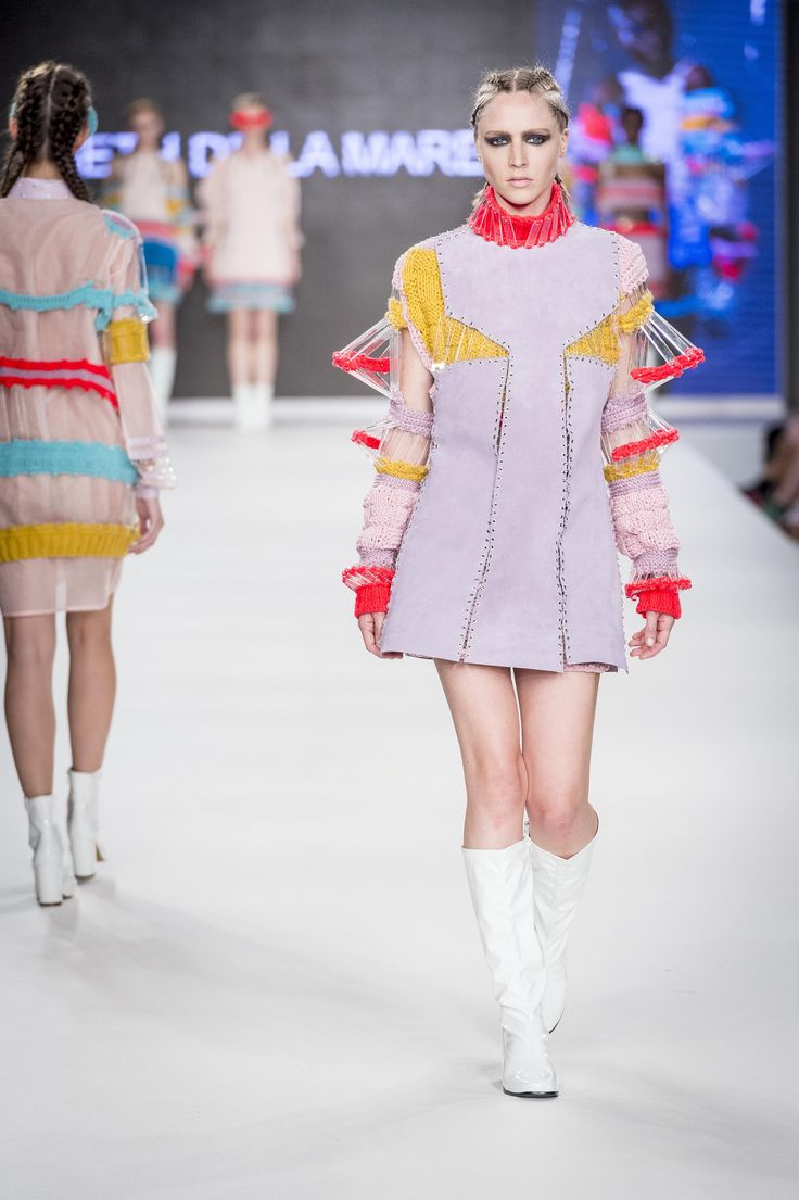 CLASS OF 2016 Graduate Fashion Week (GFW). Bethany De La Mare's sculptural collection cleverly combined leather and perspex. Inspired by a mosaic chapel in her hometown of Guernsey, as well 1960s fashion.
