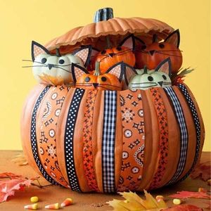 Kitty Pumpkin If you want this adorable pumpkin craft to last more than one season, consider using faux pumpkin. They're sturdy yet easy to carve and look just like the real thing.