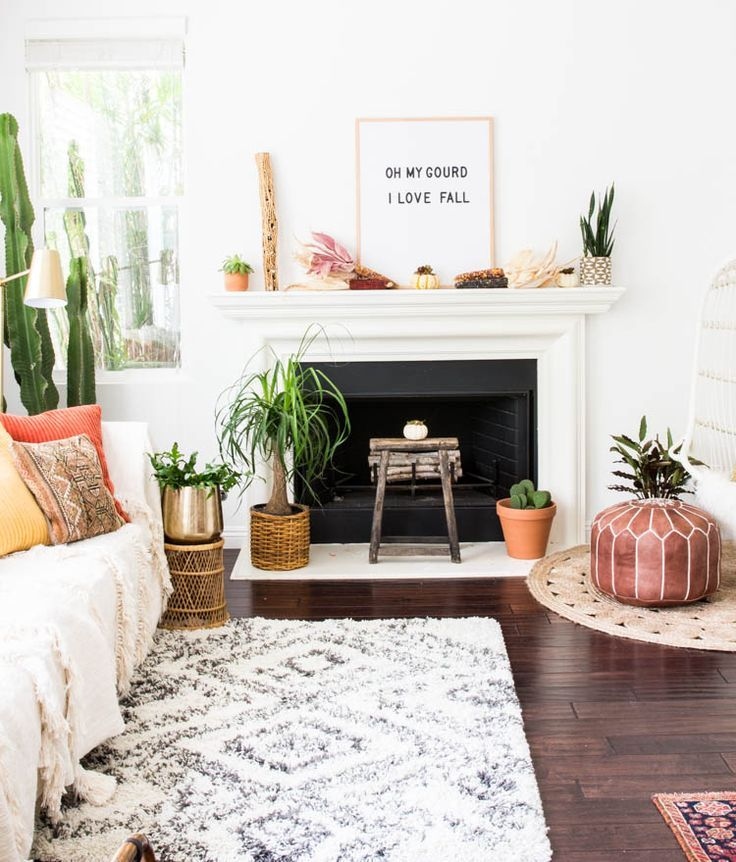 Anita Yokota boho modern eclectic design morrocan pouf kilim pillows plant babies letter board vintage rug jute serena and lily hanging chair anthropologie throw blanket tassels target brass lamp