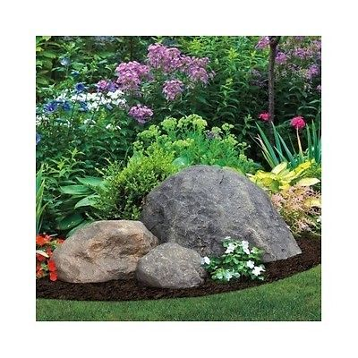 This realistic looking rock can easily be used as part of your garden or flower bed decor. It's made of fiberlite, a durable, all weather fiberglass composite, and coated with exterior-grade acrylics for long lasting beauty. Curvilinear shape resists wind, so it will stay put until you move it. Each rock cover is hand painted, so no two are alike, just like in nature. Rocks are a blend of tan and gray shades, with tan the dominant color; the degree of tan and gray colors will vary from rocks…