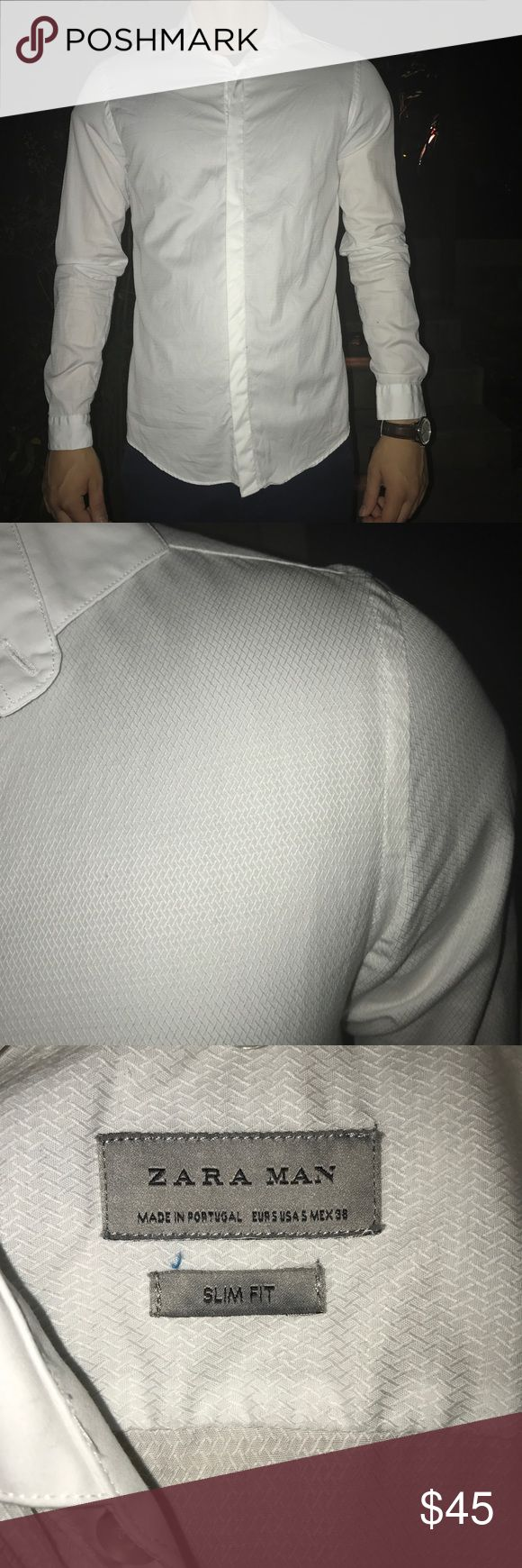 Like New ZARA Man White Slim Fit Dress Shirt Like New white slim fit dress shirt with hidden buttons and subtle texturing for a unique but polished look.  Current season. Size Small. 100% cotton. Perfect condition.  • smoke free home • cheaper on ♏️ • bundle to save on shipping • Zara Shirts Dress Shirts