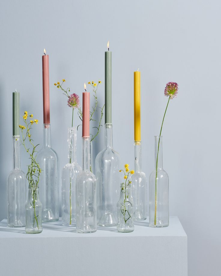 Colorful candles and flowers in glass #flowers #kaarsen # …