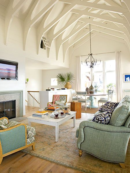 A high truss supported cathedral ceiling keeps the living for Living room vaulted ceiling