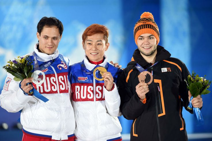DAY 9:  (L-R) Silver medalist Vladimir Grigorev of Russia, gold medalist Victor An of Russia, and bronze medalist Sjinkie Knegt of the Netherlands during the medal ceremony for Short Track Men's 1000m