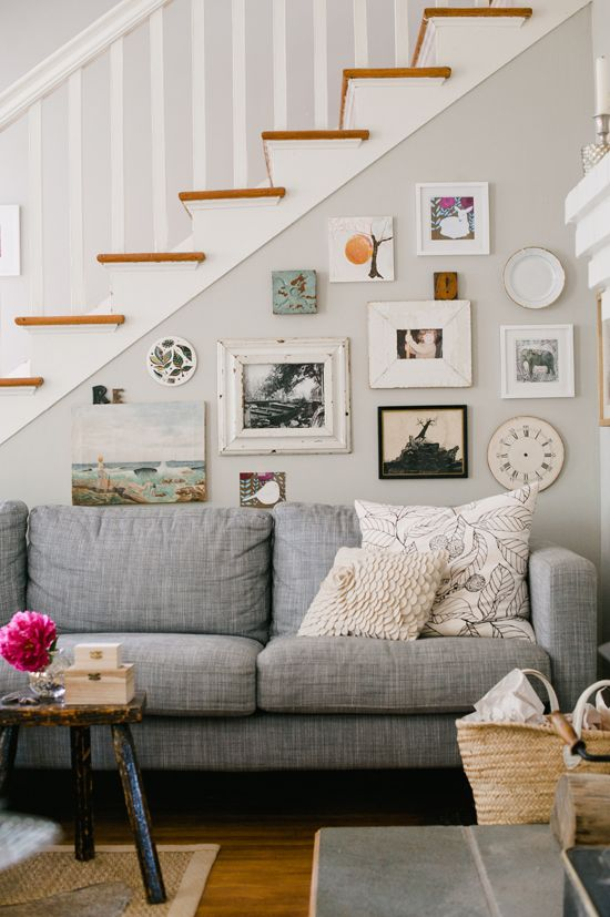 HA, this looks just like my apt, except I have black pic frames, and no stairs :): Grey Couch, Wall Collage, Living Rooms, Gray Couch, Color, Galleries Wall, Grey Wall, Grey Sofas, Gray Wall