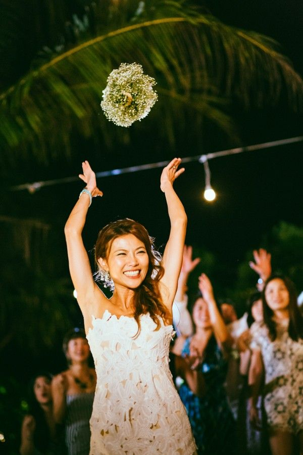 Cute bouquet toss photo by Studiokel Photography