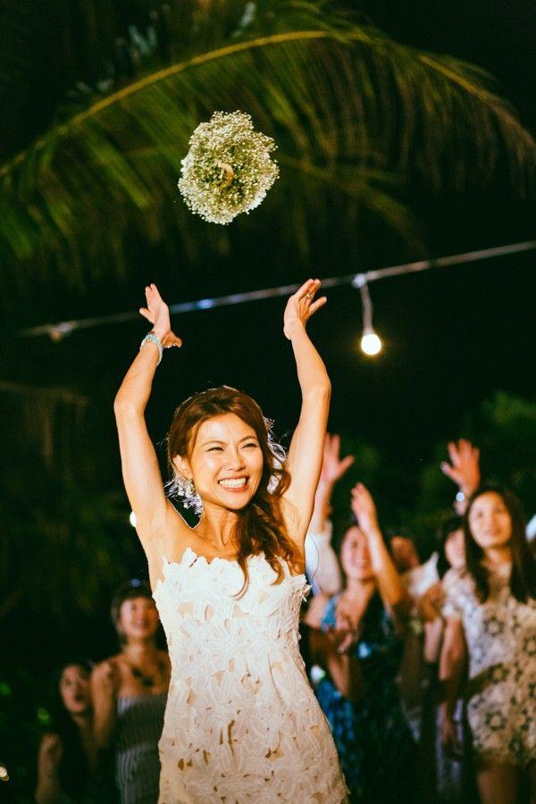 Cute bouquet toss photo by Studiokel Photography