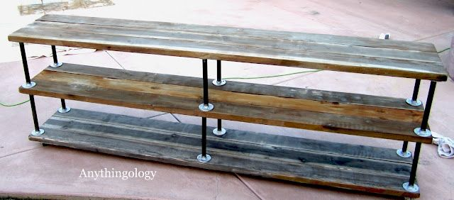 DIY Industrial console with new wood and a white vinegar and steel wool technique to distress and age the wood.