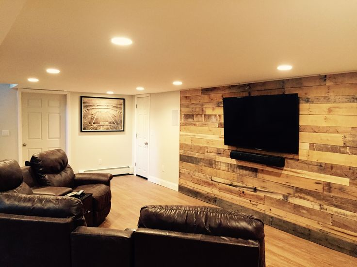 """Pallet wall in our finished basement """"Dave Cave."""" Cost: $0."""