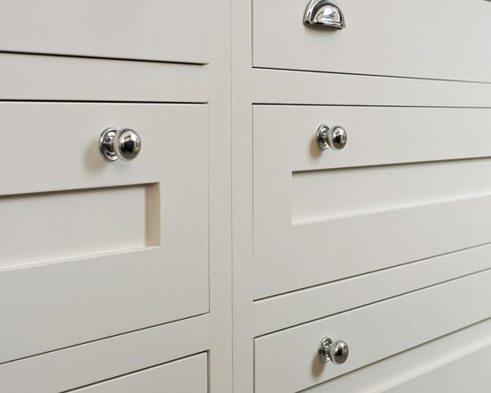 Shaker style kitchen cabinets, hand painted in Farrow and Ball strong white. Polished chrome cupped handle drawers coupled with rounded knobs.