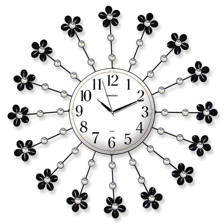 Taşlı Ferforje Çiçekli Duvar Saati  Ürün Bilgisi ;  Ürün maddesi : Metal gövde, gerçek cam Ebat : 62 cm  Mekanizması : Akar saniye, sessiz çalışır Garanti : Saat motoru 5 yıl garantili Taşlı Ferforje Çiçekli Duvar Saati Üretim  : Yerli üretim Kullanım ömrü uzundur Kalem pil ile çalışmakta Ürün fotoğrafta görüldüğü gibi olup orjinal paketindedir Sevdiklerinize hediye olarak gönderebilirsiniz