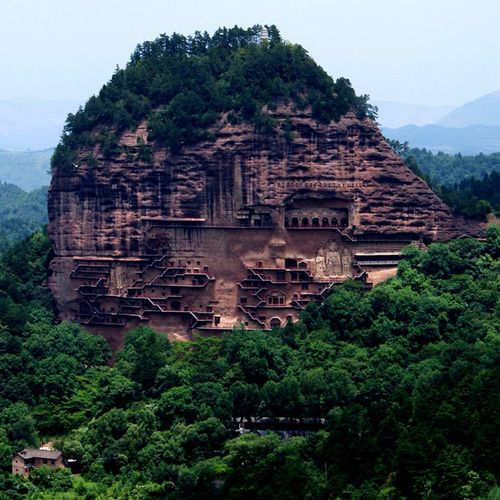 The Maijishan Grottoes are a series of caves cut in the side of the hill of Majishan in Tianshui, Gansu Province, northwest China. This example of rock cut architecture contains over 7,200 Buddhist sculptures and over 1,000 square meters of murals. Construction began in the Later Qin era (384-417 CE). They were first properly explored in 1952-53 by a team of Chinese archeologists from Beijing.