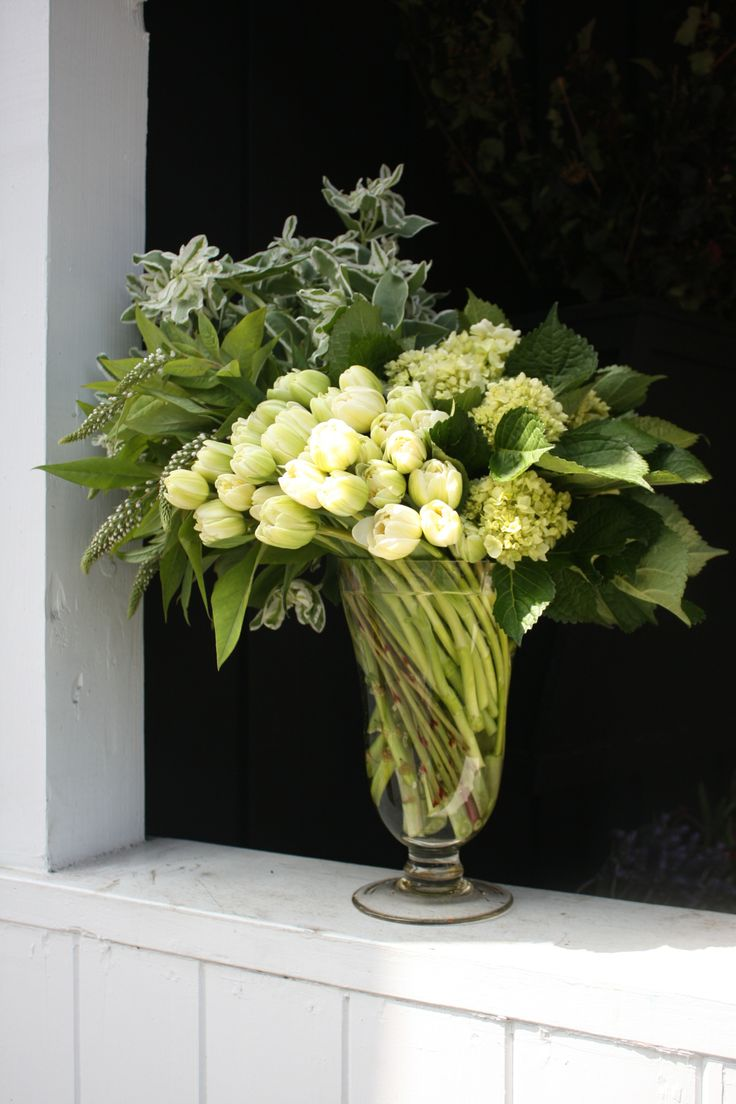 All green tulip arrangement with swirled stems