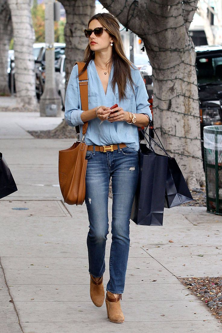 Alessandra Ambrosio wearing denim on denim paired with tan booties + belt + satchel